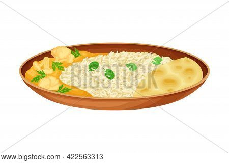 Steamed Rice With Curry Cauliflower As Indian Dish And Main Course Served On Plate And Garnished Wit