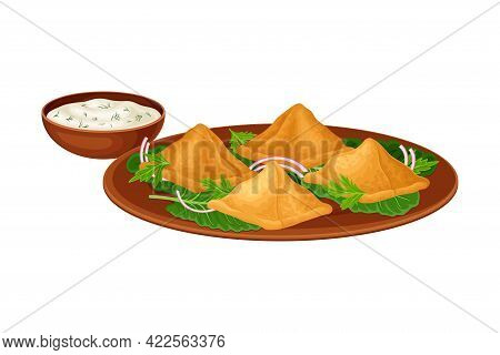 Samosa Or Baked Pastry With Filling Rested On Herbs And With Sauce As Indian Dish And Main Course Se