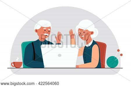 Grandparents chat on skype. Aged couple enjoying each other. The concept of online communication through the Internet and a video camera in a laptop. A call to grandparents during quarantine and isolation