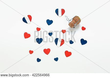 Hearts In The Colors Of The French Flag And A French Champagne Bottle Cork On A Light Background, To