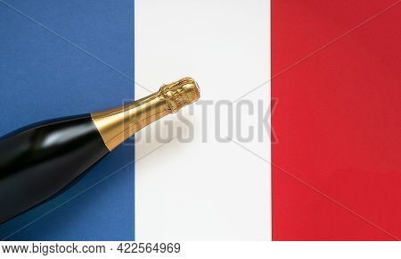 French Champagne Bottle And National French Flag, Top View, Bastille Day And French National Day Con