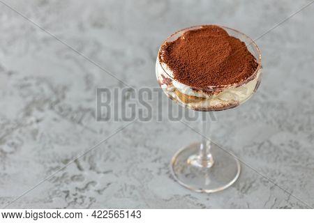 Tiramisu Dessert In A Glass On Gray Surface