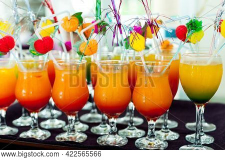 The Tray With Non-alcoholic Cocktails Of Bright Orange And Yellow Color In The Hotel Is All Included
