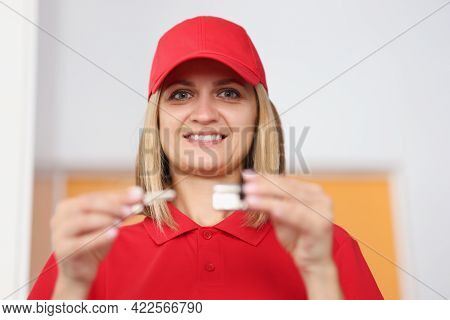 Woman Seller Holding Keyhole And Lock Core