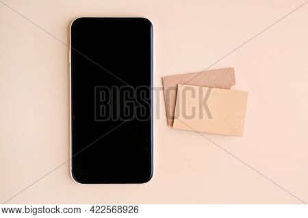 Mobile Phone Mockup With Blank Screen And Business Cards Isolated On Beige Paper. Business Card Made