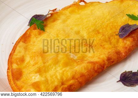 Fried Omlet On Plate Isolated On White