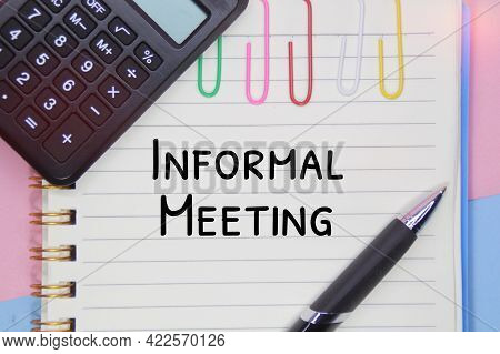 Pens, Notebooks, And Calculators With The Word Informal Meeting