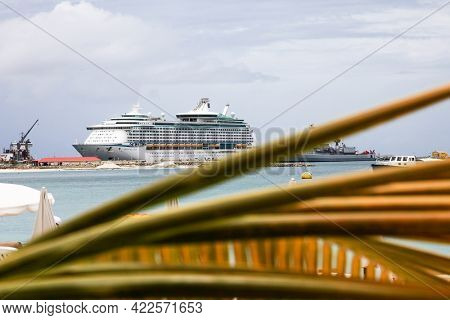PHILIPSBURG, ST MAARTEN - AUGUST 2, 2015:  Royal Caribbean ``Adventure Off The Seas`` boat with soast guard near  Great Bay walkway in Philipsburg, seen in St.Maarten
