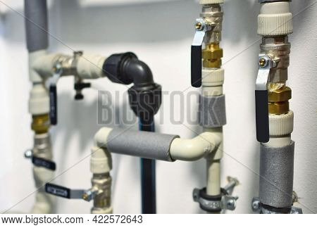 Closeup Of An Interior Home Plastic Water Piping With Water Shuts And Valves On. Water Pipes. Main W