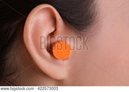 Young Woman With  Foam Ear Plug, Closeup View