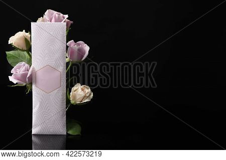 Scented Sachet And Roses On Black Background, Space For Text