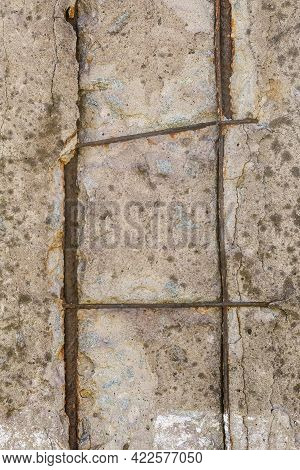 Damaged Reinforced Concrete With Exposed Rusty Steel Construction Grid