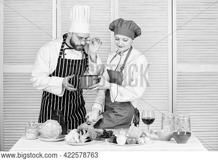 Just Try This. Woman And Bearded Man Cooking Together. Try Ingredients Before Cook. Estimate Taste.