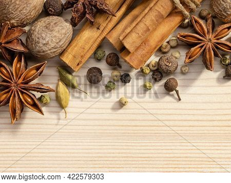 Various Culinary Spices, Anise, Cardamom, Nutmeg, Cinnamon Roll, Peppercorns On Wooden Background. S