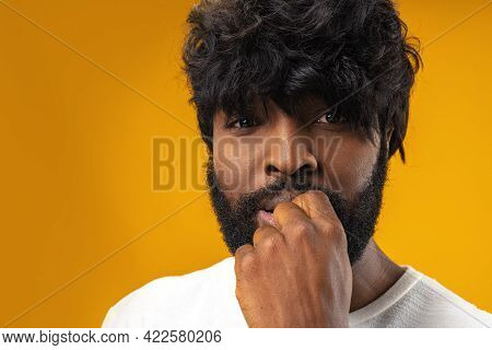 Anxious Nervous Young Black Man Against Yellow Background