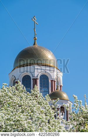 Blooming Apple Tree Against The Background Of The Orthodox Church And Blue Clear Sky. Flowering Appl