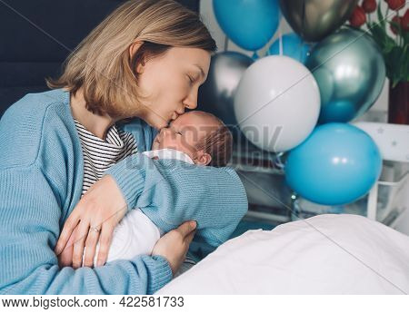 After Baby Delivery Mother And Baby At Home. Mother Holds Her Newborn In Hands. Mom And Baby Togethe