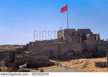 Citadel Of Kars Castle, Turkish Flag Waving Above It, Remains Of Military Barracks & Arsenals, Kars,