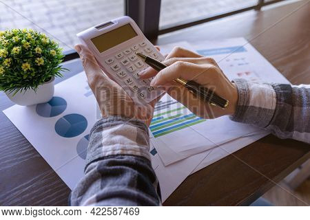 Businessman Or Young Freelance Working With Pen And Pressing The Calculator To Calculate The Accurac