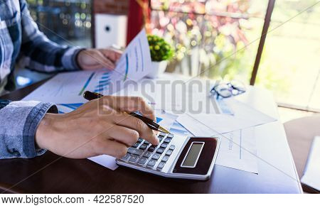 Close Up, Accounting Man Or Entrepreneurship Calculating From Income Report, Profit Statistic Docume