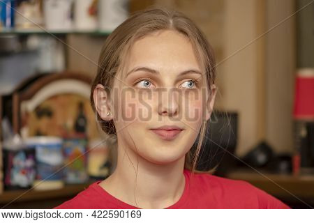 Portrait Of A Young Blue-eyed Woman 20-25 Years Old At The Bar, Close-up, Selective Focus, Gaze Dire
