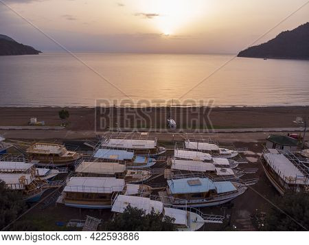 Aerial Shots Of Adrasan. Boats Are Waiting For The High Season While Standing On The Ground Seaside