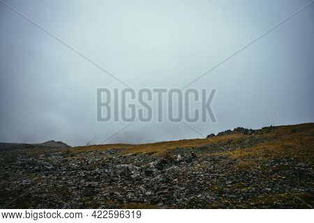 Dark Atmospheric Landscape On Edge Of Abyss In Highlands. Dangerous Mountains And Abyss Among Low Cl