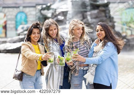 Lifestyle Outdoor Group Of Multiethnic Beautiful Young Women Clinking Cocktail Glasses Celebrating L