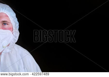 A Doctor In A Protective Suit Against Coronavirus With Scars From A Face Mask, Copy Space For Text