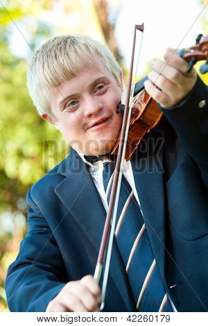 Cute Handicapped Boy Playing Violin.