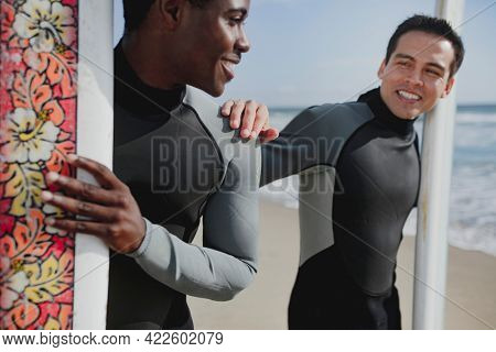 Happy surfers at the beach