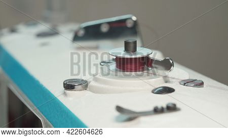 Shooting Of Spinning Bobbin Of Thread, Close-up Photo