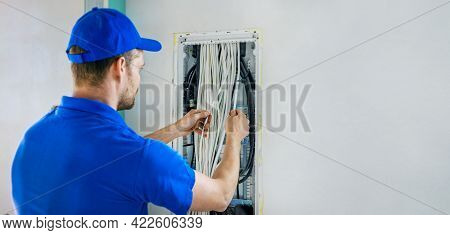 House Electrical Wiring - Electrician Working With Cables In Junction Box. Banner Copy Space