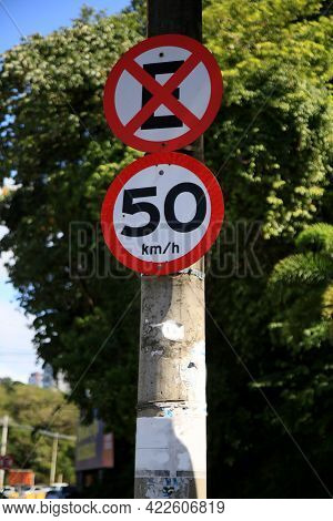 Salvador, Bahia, Brazil - May 26, 2021: Traffic Signs With A Stop And Parking Sign And A Speed Limit