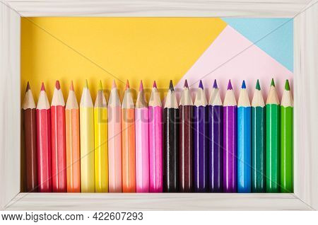 Set Of Wooden Pencils Colorful On Beautiful Background In Photo Frame, Art Concepts.