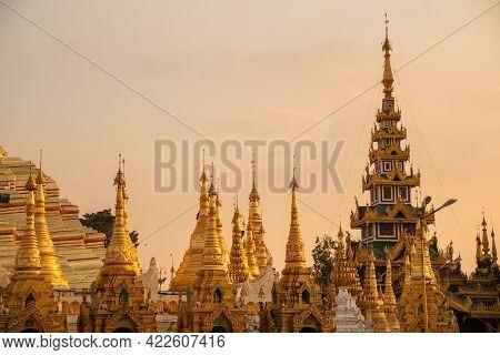 Group Of Stupa In Area Of Shwedagon Pagoda Is Yangon's Most Famous Landmark In Myanmar At Sunset. Sh