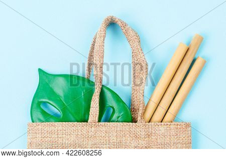 Bamboo Straws Tube Drink Water In Sack Back On Blue Background. Eco - Friendly Concepts.