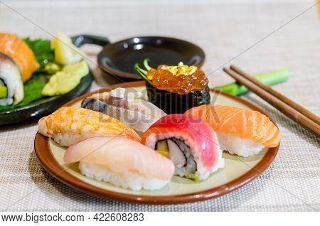 Sushi Salmon And Tuna On Leaf Dish In Japanese Food Restaurant.
