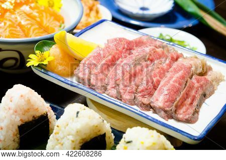 Sliced Grilled Strip Loin Rare Degree Of Ripeness Beef Steak Served With Salt And Lime.
