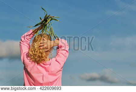 Beautiful Woman Stands With Her Back To The Frame, In Her Hands Above Her Head Ears Of Wheat. Blue S