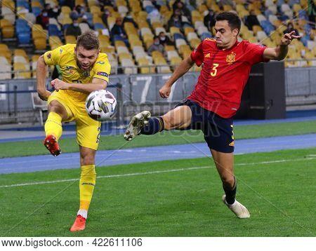 Kyiv, Ukraine - October 13, 2020: Oleksandr Karavaev Of Ukraine (l) Fights For A Ball With Sergio Re