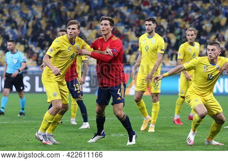 Kyiv, Ukraine - October 13, 2020: Illia Zabarnyi Of Ukraine (l) Fights For A Ball With Pau Torres Of