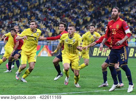 Kyiv, Ukraine - October 13, 2020: Ukrainian (in Yellow) And Spanish Players Fight For A Ball During