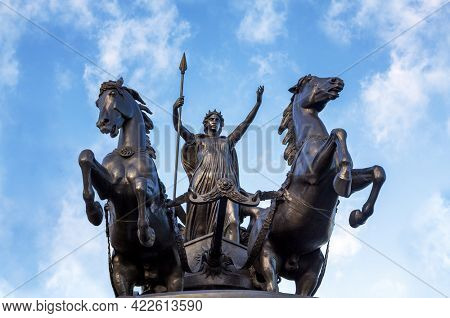 Bronze Boudica staue against summer sky in London, UK. This staue was commissioned in the 19th Century by Queen Victoria, and represents Boudica, or Boadicea, queen of the Celtic Iceni tribe.