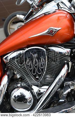 Fuel Tank And Engine Of Kawasaki Vulcan 900 Classic Motorcycle. Motorcycle Detail In Red, Logo. Shin