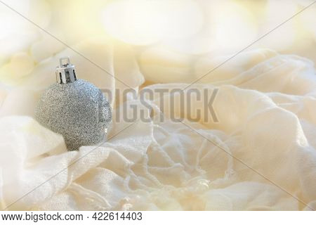 Partial Blurred Festively Decorated Christmas Shiny Ball On Folded Fluffy Blanket, Bokeh Effect, Win