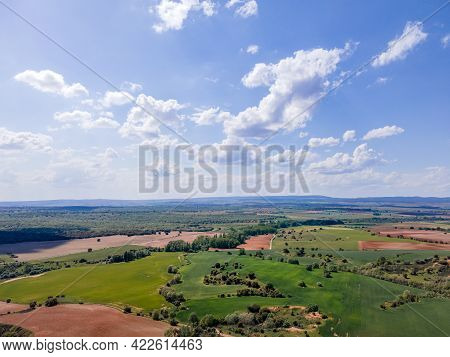 Aerial View Of Fields Of Castile With Agricultural Plots And Blue Sky With Clouds. Castile Spain.