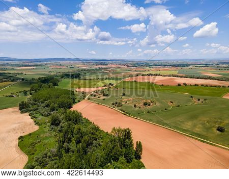 Aerial View Of Fields Of Castile With Agricultural Plots And Blue Sky With Clouds. Castilla.