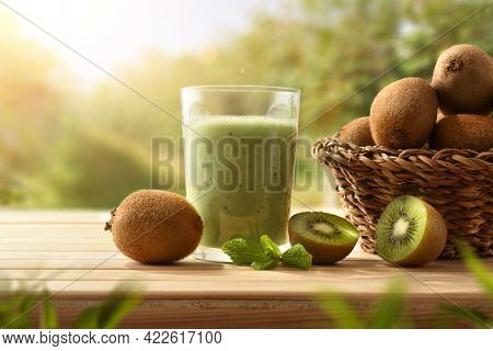 Freshly Collected Kiwi Juice From Organic Agriculture In Kiwi Tree Plantation On Wooden Table. Front