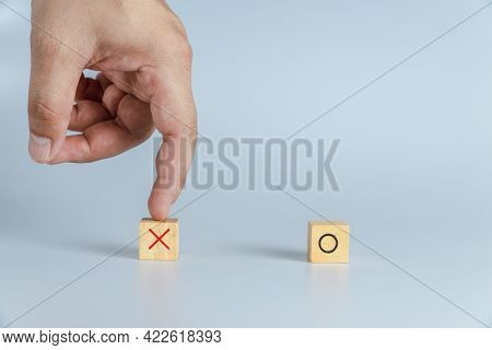 Hand Hold Wooden Block. Ox Game Or Tic Tac Toe Wooden Box. Business Marketing Strategy Planning Conc